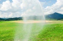 Big sprinkler in graden Stock Images