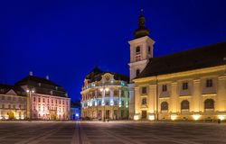 The Big Square with the Citty Hall in Sibiu at night in Transylvania region, Romania.  stock photo