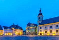 The Big Square with the Citty Hall in Sibiu at sunrise in Transylvania region, Romania.  royalty free stock image