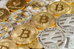 Stack of bitcoin, ripple, etherum and litecoin coins. Virtual currency concept. stock images