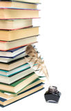 Big stack of books and inkwell on a white background close-up Royalty Free Stock Image