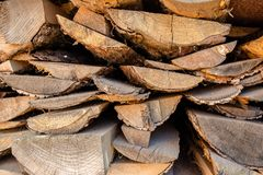 Big stack of brown planking made from trees settled at the yard in the village. In Ukraine royalty free stock photo