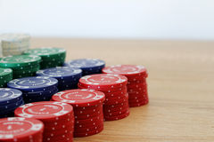 Big stack of colorful poker chips on a table Stock Images