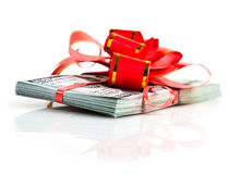 Big stack of dollars with red bow Stock Photo
