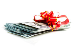 Big stack of dollars with red bow royalty free stock image