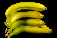 A big stack of fresh yellow and green bananas fruit. Fruits of four different banana cultivars A banana is an edible fruit – botanically a berry[1][2 royalty free stock images