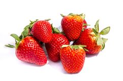A big stack green top red strawberry`s stock images