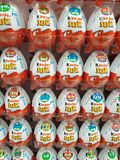 Kinder eggs. Big stack of Kinder eggs in supermarket store prepared for Easter holiday royalty free stock photography