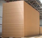 Big stack of MDF boards. Medium Density Fibreboard. Selective focus stock photography