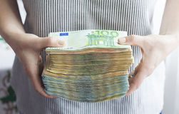Big stack of money in hands. Concept for business investment Stock Photos