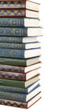 Big stack of old antique books. Isolated royalty free stock image
