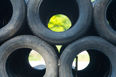 Big stack of old tires. A big stack of old tires royalty free stock images