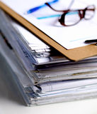 Big stack of papers ,documents on the desk Stock Photo