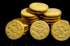A big stack of sweet round cookie`s. A cookie is a baked or cooked food that is small, flat and sweet. It usually contains flour, sugar and some type of oil or Stock Image