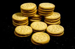 A big stack of sweet round cookie`s. A cookie is a baked or cooked food that is small, flat and sweet. It usually contains flour, sugar and some type of oil or Royalty Free Stock Photography