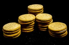 The big stack of sweet round cookie`s in a line. A cookie is a baked or cooked food that is small, flat and sweet. It usually contains flour, sugar and some type Royalty Free Stock Image