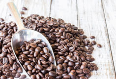 Big stainless steel scoop of coffee beans Stock Images