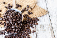 Big stainless steel scoop of coffee beans Royalty Free Stock Image