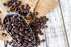 Big stainless steel scoop of coffee beans Royalty Free Stock Images