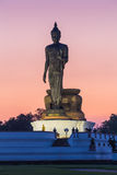 Big standing Buddha statue after sunset Royalty Free Stock Photos
