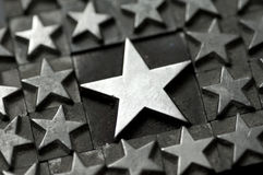 Big Star. A large star surrounded by smaller ones photographed using vintage type charcters. See my other member portfolio for more vintage type images stock image