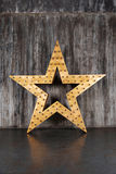 Big star on the background of concrete wall Stock Image