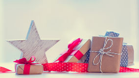Big star shaped toy, red ribbon and beautiful gifts on the wonde Stock Photography