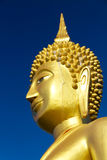 Big Statue Buddha. Golden big statue Buddha blister colour by sunlight effect royalty free stock photo