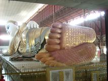 a big statue in a temple in burma stock photos