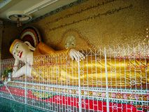 a big statue in a temple in burma stock image
