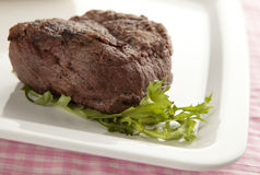 Big steak. On a plate with salad Stock Photo