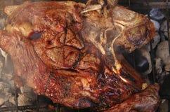 Big steak on roast grid Royalty Free Stock Images