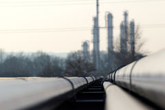 Big steel long pipes go to oil refinery Royalty Free Stock Photos