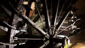 Big steel watemill wheel rotates slowly close up stock footage