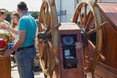 KALININGRAD, RUSSIA - JUNE 19, 2016: Big steering wheel on the barque Kruzenshtern prior Padua. Big steering wheel on the barque Kruzenshtern prior Padua moored royalty free stock image