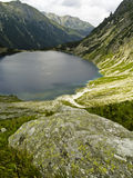 Big stone in background lake. Beauty aerial view on lake in polish tatra mountain Stock Images