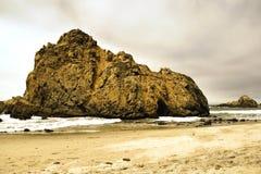 Big stone and beach at pfeiffer beach Stock Image
