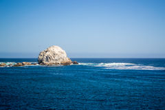 Big stone in the beach. Wide view of a beach in Algarrobo Chile Royalty Free Stock Photo