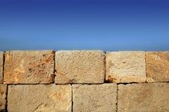 Big stone bricks masonry wall on port blue sky. Big stone bricks masonry wall on port dock under blue sky stock photos