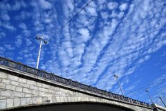 The Big Stone Bridge in Moscow. Blue sky with unusual clouds background. Low angle view. Color photo royalty free stock photography