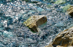 Big stone in clear water Royalty Free Stock Photo