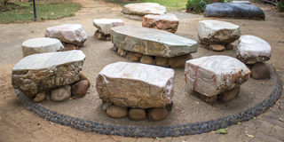 Big stone Garden Table. And nine chairs Royalty Free Stock Image