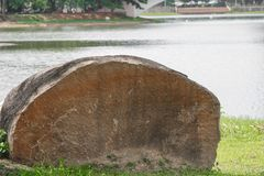 Big stone in the grass background.  Royalty Free Stock Images