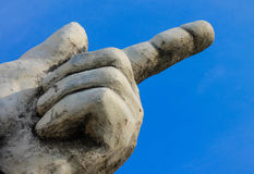Big stone hand with pointing finger isolated Royalty Free Stock Photography