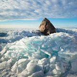 Big stone in the ice on the Baltic Sea coas Royalty Free Stock Image