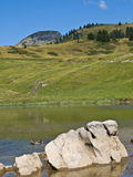 Big stone in the  lake Royalty Free Stock Photos