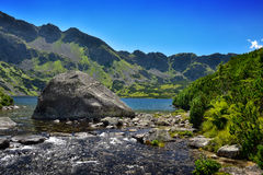 Big stone in a lake in the Tatra mountains Royalty Free Stock Photography