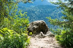 Big stone on mountain cliff with stunning panorama view Stock Photo