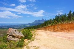 Big stone next to road. In amazing mountains. Shot in Hottentots Holland Mountains, Vergelegen area, near Somerset West, Western Cape, South Africa Stock Photography