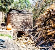 Big stone outside brick oven for baking chimeneas in Mexico royalty free stock images